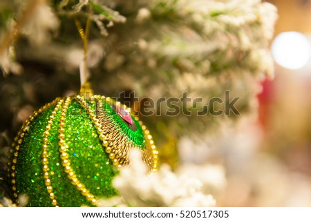 Christmas ball on the tree in the background with other decorations and garlands. copy space.