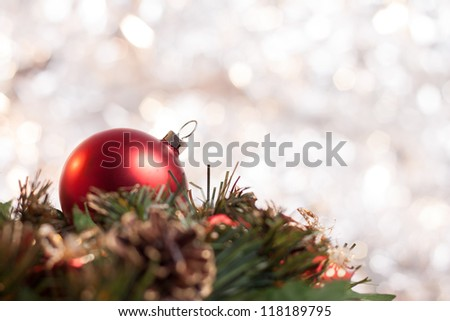 Christmas ball on wreath with abstract light background - stock photo
