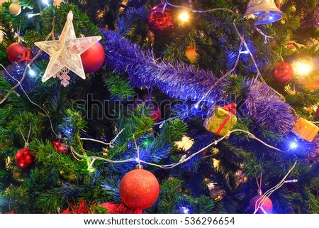 Christmas Ball Ornaments Decoration Hanging On Fir Tree Over Red Circle Bokeh Blurred Night Light Background