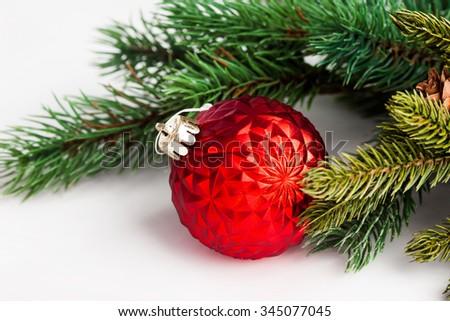 Christmas ball with green fir - stock photo