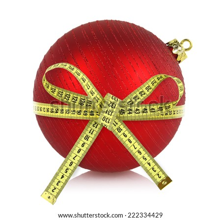 Christmas ball with measuring tape isolated on white - stock photo