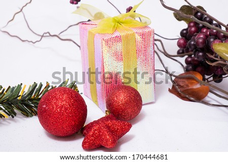 Christmas ball with pine branch and gifts on white background