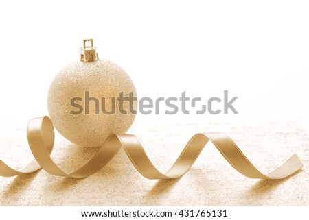 Christmas ball with ribbon on light textured background - stock photo