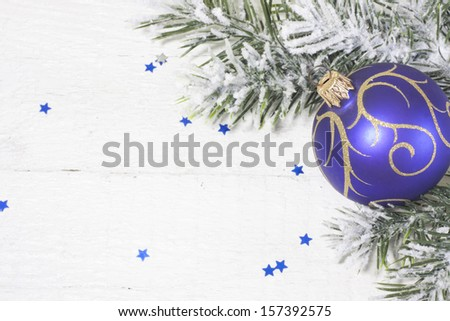 Christmas ball with tree on white boards abstract background - stock photo