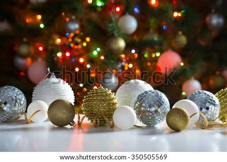 Christmas balls against the backdrop of a festive Christmas tree - stock photo