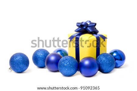 Christmas balls and a gift - stock photo
