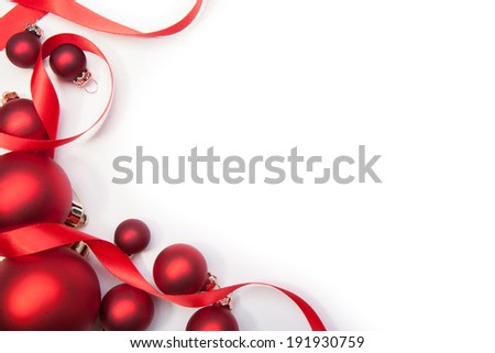 Christmas balls and a red ribbon on a white background - stock photo