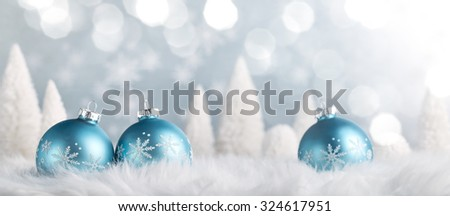 Christmas balls and fir tree on snow - stock photo