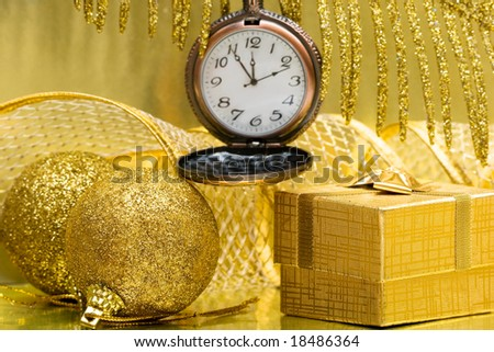 Christmas balls and gift box with clock - stock photo