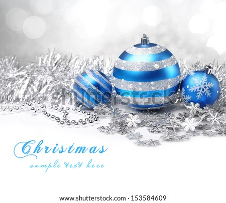 Christmas balls and gifts on abstract background. - stock photo