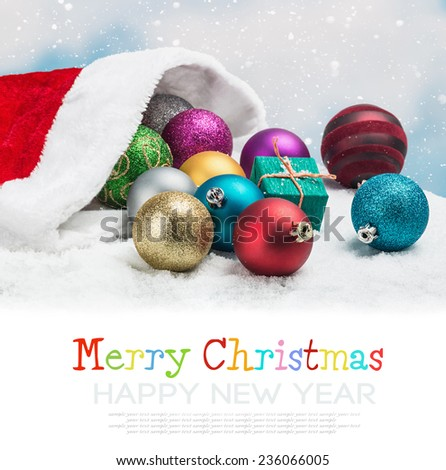 Christmas balls and gifts on the background of sky. The text serves as an example and can be easily removed from the background - stock photo