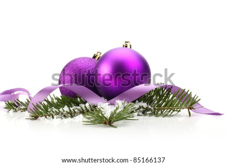 Christmas balls and green spruce branch - stock photo