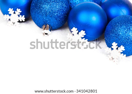 Christmas balls and snowflake on white background - stock photo
