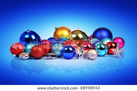 Christmas balls and toys on blue background - stock photo