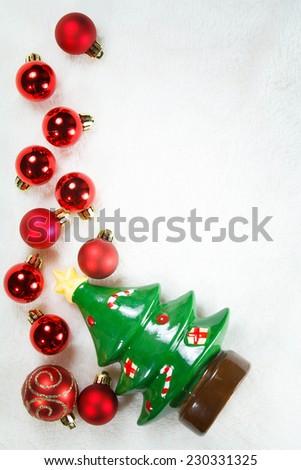 Christmas balls and tree on White fur background , Christmas concept - stock photo