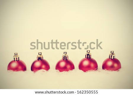 Christmas balls arranged in a row - stock photo