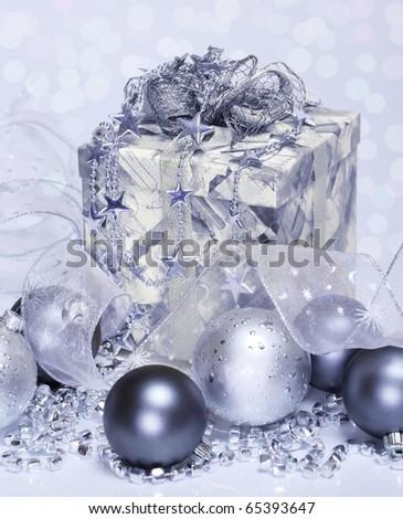 Christmas balls beside present box - stock photo