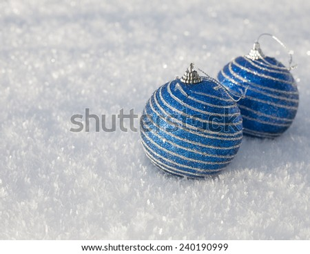 Christmas balls blue brilliant hanging on snow in winter  - stock photo