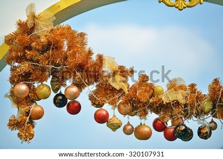 Christmas balls decoration, colorful Christmas decoration from hanging colorful baubles with blue sky background - stock photo