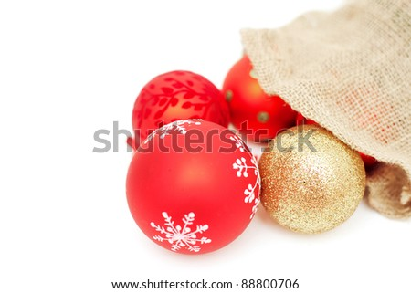 christmas balls falling from bag and empty space for your text - stock photo