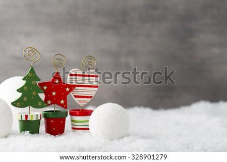 Christmas balls, greeting card and fir tree on snow. - stock photo
