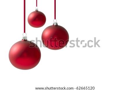 Christmas balls hanging on reds ribbons over a white background background - stock photo