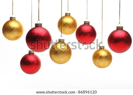 Christmas balls hanging over white background. - stock photo