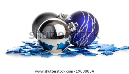 Christmas balls lying on blue stars, isolated