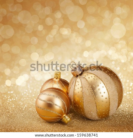 Christmas balls on a golden background - stock photo