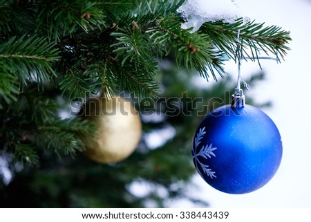 Christmas balls on a real Christmas tree in Siberia in Russia