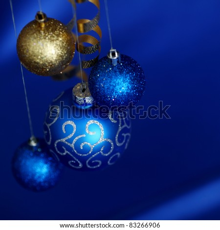 christmas balls on blue satin background
