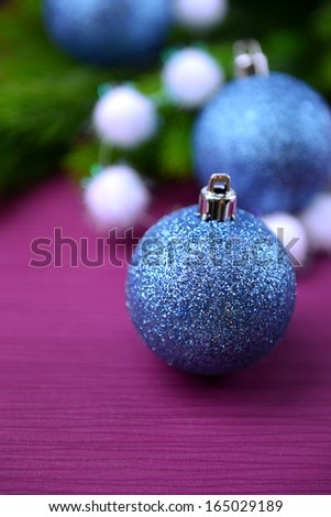 Christmas balls on fir tree, on color background - stock photo