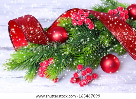 Christmas balls on fir tree, on wooden background - stock photo