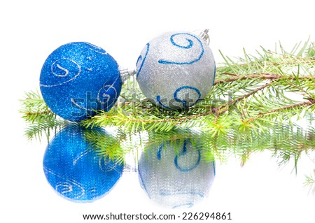 Christmas balls on ice at white background - stock photo