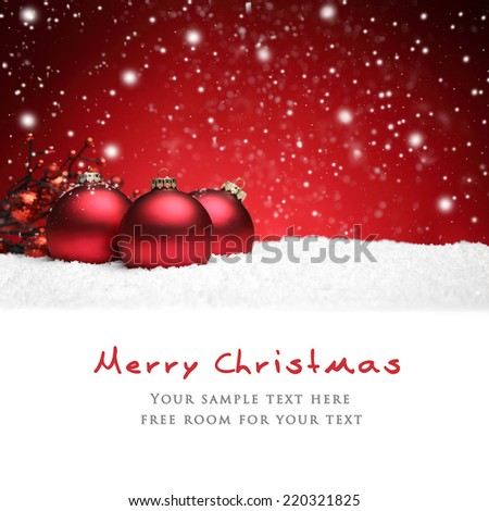 Christmas balls on snow over red background - stock photo
