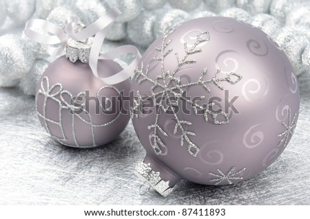 Christmas balls on the festive silver background - stock photo