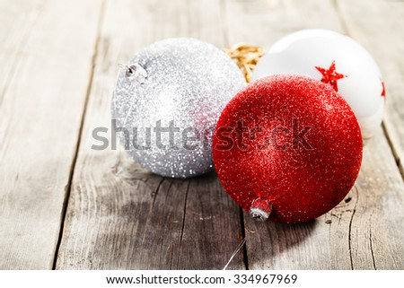 Christmas balls on wooden background - stock photo