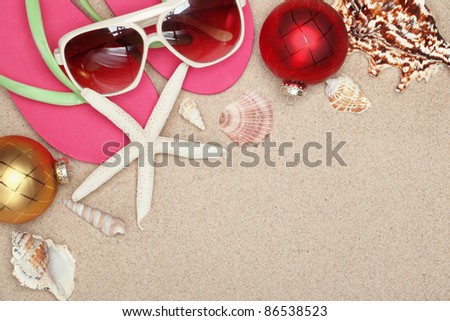 Christmas balls,seashells and  with beach accessories on sands,Closeup. - stock photo