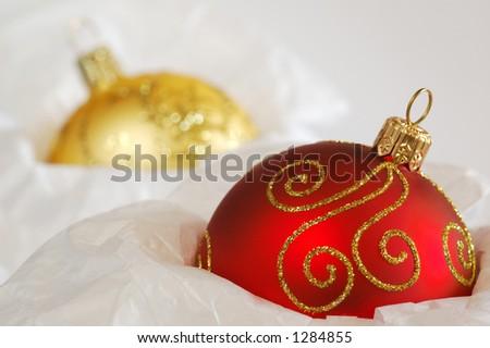 Christmas Balls Stored in Tissue Paper. Shallow DOF. - stock photo