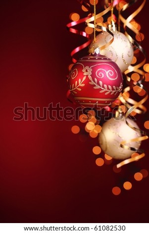 Christmas balls,streamers and abstract bokeh with copy space. - stock photo