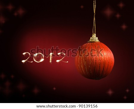 Christmas balls,streamers over red background - stock photo