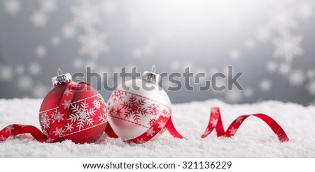 Christmas balls with decoration on shiny background - stock photo