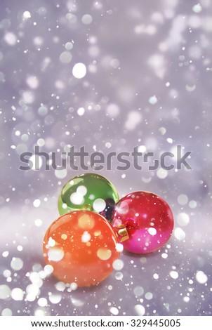 Christmas balls with falling snow. Magic christmas time. - stock photo