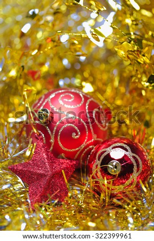 Christmas balls with five-pointed star in the golden tinsel defocused backgrounds - stock photo