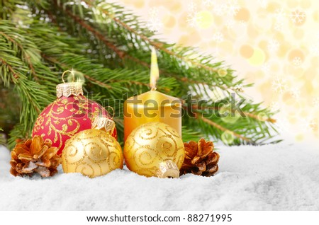 Christmas balls with gold candle over white