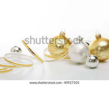 Christmas balls with ribbons on white background - stock photo