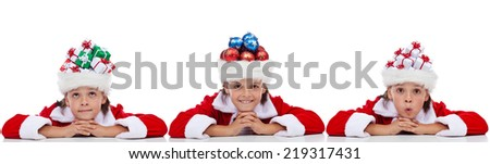 Christmas banner with kids wearing santa hats full of holidays items - isolated - stock photo