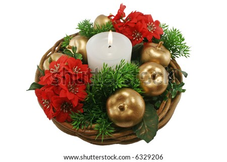 Christmas basket arrangement with candle, golden apples and foliage. - stock photo