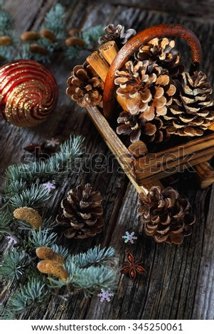 Christmas basket with cinnamon sticks and pine cones