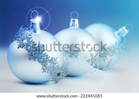 christmas bauble and decorative stripes on azure background - stock photo